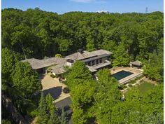 #modern property in #minnetonka #minnesota.  Stone architectural gem, on a 2.2 acre private wooded lot. Accessed by a long gated driveway, this Minnetonka home is only 10 min. from DT & 5 min. to Wayzata/Lake Minnetonka. Designed by Charles Stinson & built by Streeter & Associates, this home feels like a retreat, & also provides a perfect setting for elegant entertaining. With influences of Asian architecture & Frank Lloyd Wright, stone pillars throughout, clerestory windows. #beautifulhomes