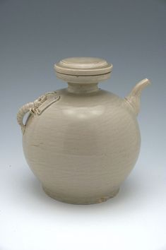 Covered Globular Ewer with a Faceted Spout and a Handle in the Form of a Shrimp Vietnam, 13th-14th century White stoneware with pale celadon glaze over appliqué decoration, 20.1 x 17.4 cm  Harvard Art Museum, 2006.169.8.A-B