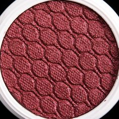 ColourPop Porter Super Shock Shadow - It's a slightly muted, medium-dark cranberry with hints of warm, pinky-copper tones and subtle gold sparkle.