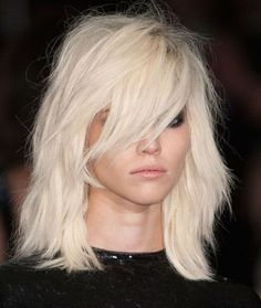 Like the long bangs and length; rocker style