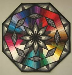 Quilts radiating from the center... and this woman's blog makes it sound like it was no big deal to make! If only!
