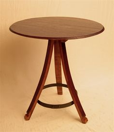 Bistro table made out of wine barrels - it's got the staves and the metal hoop and everything. $325