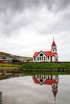 A pretty church on one of the Faroe Islands, Denmark. The Faroe Islands are an archipelago between the Norwegian Sea and the North Atlantic Ocean, approximately halfway between Norway and Iceland, 320 kilometres north-northwest of mainland Scotland.