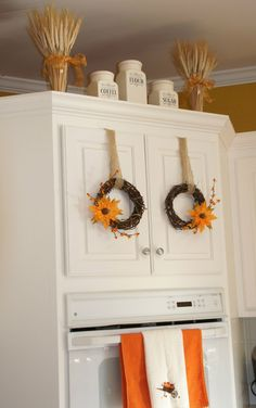 Mini wreaths on cabinet doors