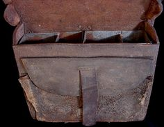 The box is made from russet leather and is equipped with cast buckles for attachment of the over the shoulder sling. The closing finial is made of lead. The tins are made in two pieces and are original to the box. Archibald and Richard McKensie were Charleston saddle and harness makers in the decades leading up to the war.