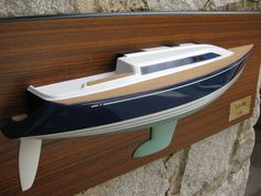 """* This is the 24"""" half hull model of the X 382 yacht. The model is mounted on the Teak backboard. The size of the backboard is 29"""" x 12"""". The model weight is 10 LBS. ................. Please contact Mas at halfhull@gmail.com or visit the web at www.halfhull.net for more model information. Zuma Boat (404) 272-7889."""