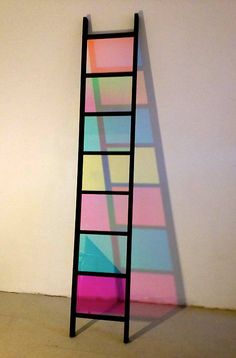 We love the blocks of coloured shadow cast through dichroic glass inserts in Black Ladder by Stephen Dean.