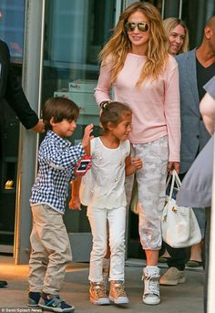 Stylish mommy! Jennifer Lopez steps out with her twins Max and Emme in New York City on Thursday