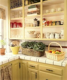 When combining different hues in a kitchen, you don't always have to go for high drama. In this kitchen, the upper shelves wear an ever-so-slightly paler version of the citron yellow hue that cloaks the base cabinets. The lighter color on top helps to open up the space and prevent the shelves from feeling too weighty, and the … More