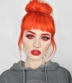 35 Edgy Hair Color Ideas to Try Right Now Sunset Orange hair dye with bangs and bun haircut by Orange Hair Dye, Orange Hair Bright, New Hair, Your Hair, Cheveux Oranges, Corte Y Color, Coloured Hair, Dream Hair, Rainbow Hair