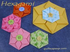 Folded hexagon roses tutorials-http://www.quiltscapesqs.com/2013/07/hexarose.html and http://www.rileyblakedesigns.com/cutting-corners/2013/06/03/hexagami/ also a video-http://art2inspiretech.blogspot.com/2013/02/fabric-folded-and-twisted-hexagon.html;