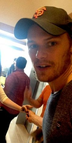 Sam Heughan who plays my literary husband Jamie Fraiser, he's Scottish, AND he's a Giants fan!