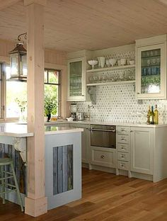 nice simple cabinet door design - love the clear glass, would look great with LED lighting inside and under the cabinet