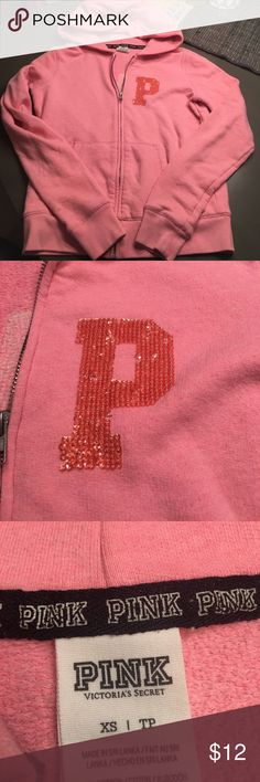 Pink colored pink brand full zip up hoodie size xs Pink pink brand with beaded letters full zip up hoodie. Size xs. No string . No holes rips or stains. Smoke free home. PINK Victoria's Secret Tops Sweatshirts & Hoodies