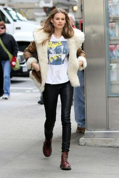 Behati Prinsloo: 'Hawaii Five-O' Guest Star!: Photo Behati Prinsloo flashes a peace sign while donning a t-shirt with the rock band The Police on Monday (November in New York City. Behati Prinsloo, Peau Lainee, Chloe, Sheepskin Coat, Vogue, Model Street Style, Models, Look Cool, Runway Fashion