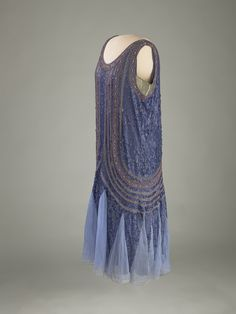"Flapper-Style Evening Gown: ca. 1923–1929, satin trimmed with sequins and glass beads. Worn by Grace Coolidge. ""...[she] gave the dress to her White House maid, Maggie Rogers.""    Housed in the ""The First Ladies"" Gallery (opened 11/19/2011) of the National Museum of American History."