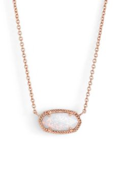 A glittering white opal sparkles at the center of this mesmerizing, versatile pendant necklace in rose gold.