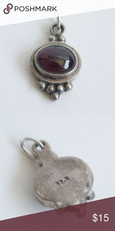 Red Sterling Silver Pendant $$OBO$$ 92.5 stamped, about .75 inches long, pretty sure the stone is a garnet  CLOSET CLEAR OUT!!!! Taking all offers made using the button, I especially give great deals on bundles. Note: I do not take offers of $5 or less. Also I do not trade $ Jewelry Necklaces