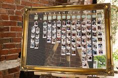 Gold Guilt Mirror with Chicken Wire & Pinned Photographs Table Plan | Shustoke Farm Barns Warwickshire | Paul Joseph Photography | http://www.rockmywedding.co.uk/jacqui-ross/