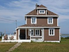 House for sale in Les Îles-de-la-Madeleine - $169,000 Garage Doors, Outdoor Structures, Outdoor Decor, Home Decor, Madeleine, Homemade Home Decor, Interior Design, Home Interiors, Decoration Home