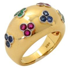 Gold Domed Ring with Rubies, Emeralds and Sapphires. This unusual 18 karat ring has clusters of rubies, emeralds and sapphires. England, 1950's.