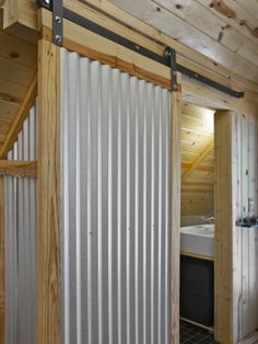 Sliding door of corrugated metal.