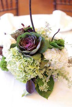 centerpieces featuring ornamental kale, artichokes, hydrangea, scabiosa pods and more!