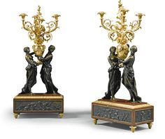 A pair of French gilt-and patinated-bronze marble candelabrain Louis XVI style, Napoleon III, circa 1870 with two maidens holding a vase issuing three scrolling branches, on a rouge griotte base with relief plaques depicting the Arts and Sciences with putti, on toupie feet