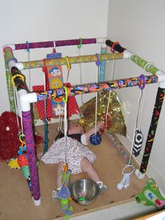 Instructions on how to build a PVC pipe toy gym. I may have to make one of these if I ever have another baby. Baby Sensory Play, Sensory Toys, Sensory Activities, Baby Play, Infant Activities, Activities For Kids, Pvc Projects, Baby Gym, Special Needs Kids