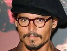 Johnny loves his hats...and his glasses