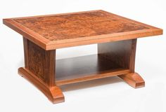 """Here's a shot of the entire coffee table in Walnut and Walnut Burl.  There's a thin line of Mother of Pearl inlay surrounding the Burl top panel.  For a size reference the top is about 2"""" thick, I think the table was around 40"""" square or so.  The style is vaguely Arts and Crafts but was really intended to go with the dining table designed for the same client."""