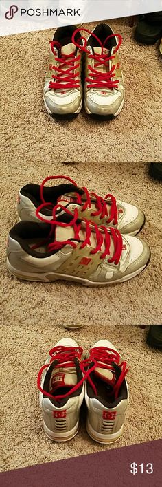 Men's DC shoes Size 12 men's DC shoes. Worn as shown. Silver, white, and red. DC Shoes Sneakers