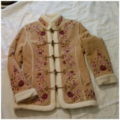 Beautiful Embroidered Leather Coat Beautiful Embroidered Leather Coat. See pictures of tag and measurement.  Says Large but runs REALLY  Small,  more like a medium.  Never worn. Heavy. Warm. Gorgeous! Only Reasonable offers considered. Jackets & Coats