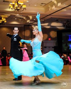 Dancing American Style Tango at the Florida Superstars Dancesport Championships 2015.  With Charlene Proctor and Michael Choi. Photo by Alex Rowan Dancesport Photography. Dress by Dore Designs.https://www.facebook.com/photo.php?fbid=10153080326714424
