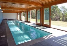An Extravagant Swimming Pool Inside Semi Modern House Indoor Idea With Inground Liners And Ladder Wooden Ceiling