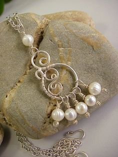 Hey, I found this really awesome Etsy listing at http://www.etsy.com/listing/70788105/white-freshwater-pearls-and-silver