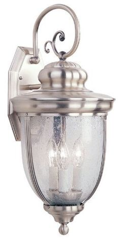 "Livex 2562-91 Windham Outdoor Wall Lantern Brushed Nickel by Livex. $229.90. Livex Lighting 2562-91 Brushed Nickel Outdoor Wall Lantern Windham 9.75"" W x 21"" H x 11"" E, 3x60W Cand Base, Seeded Glass Glass / Shade Backplage: 4.25""W x 9.25""H TTM (height from top of fixture to mounting): 6.75"" Height Solid Brass"