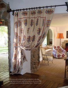 Curtain as room divider idea.  Cute. Would be good to close off area around desk in kitchen.