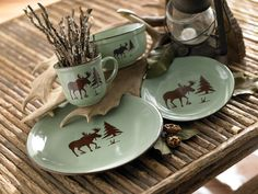 Contemporary Meadow Moose Dinnerware Set, a softer tackle conventional stoneware design. Contemporary Meadow Moose Dinnerware Set, a softer tackle conventional stoneware designs. By Black Forest Decor Rustic Dinnerware, Dinnerware Sets, Country Decor, Rustic Decor, Woodland Decor, Rustic Wood, Moose Lodge, Moose Hunting, Pheasant Hunting