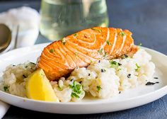 This seared salmon with lemon risotto is an elegant main course perfect for entertaining or if you are spending date night at home. A creamy risotto and a crispy seared salmon fillet, all coming together with plenty of lemon, parsley and black pepper.