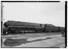 EXTERIOR VIEW, LEFT SIDE OF LOCOMOTIVE WITH TENDER AND AUXILIARY TENDER. - Norfolk & Southern Steam Locomotive No. 611, Norris Yards, East of Ruffner Road, Irondale, Jefferson County, AL.