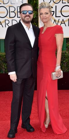 Ricky Gervais in a black suit and wife Jane Fallon in a red dress