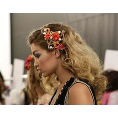 We got a side view of Gigi's intricate braids, which weaved through bright flowers.