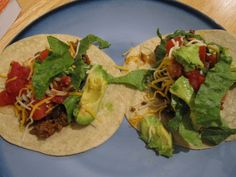 tacos! we made ours with guacamole and sour cream as well. the grown ups also added jalapenos.