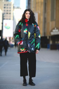 Street Style Stans Outside The Hood By Air Show #refinery29  http://www.refinery29.uk/2016/02/104740/hood-by-air-street-style#slide-8  Black, rubber-toe sneakers and a pretty, patterned coat....