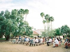 cross-back wood chairs for a wedding ceremony - Melissa Jill Photography