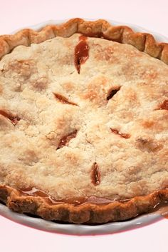 NYT Cooking: This rhubarb pie contains no distractions, like strawberries. The crust is made with shortening. (Butter is fine if you want a French tart, but it's not American pie unless it's made with shortening, the author Anne Dimock said.) The top is marked with 8 razor-thin vents.