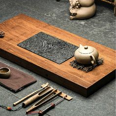 Traditional Chinese teaism tea set, made from weight Bamboo and black stone . Super natural and elegant. This price cointains 1 tea tray