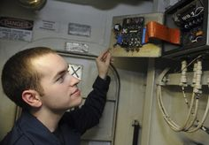 PACIFIC OCEAN (May 18, 2013) Internal Communications Electrician Fireman Tyler Simpson, of Billings, Mont., checks circuit board for broken components and wiring aboard the aircraft carrier USS Nimitz (CVN 68). Nimitz is deployed to the U.S. 7th Fleet area of responsibility conducting maritime security operations and theater security cooperation efforts. (U.S. Navy photo by Mass Communication Specialist Seaman Nathan R. McDonald/Released)