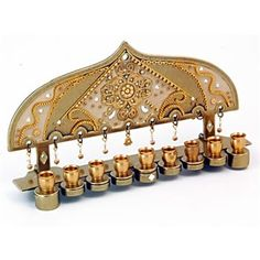 Jewish Gifts - Made from stainless steel, this Hanukkah menorah is designed by Israeli Judaica artist, Ester Shahaf . The Hanukkah menorah Jewish gift  is decorated with Swarovski crystals, brass and copper accents.